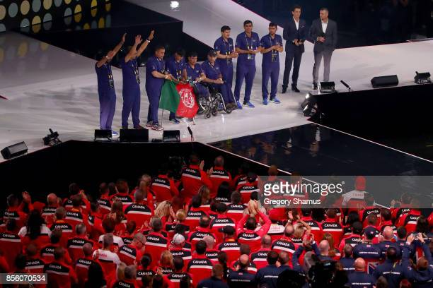 Team Afghanistan pose on stage to receive the Land Rover Above and Beyond Award during the closing ceremony of the Invictus Games 2017 at Air Canada...