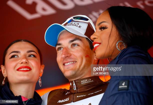 Team AG2R La Mondiale rider France's Nans Peters celebrates his victory during the podium ceremony after the stage seventeen of the 102nd Giro...