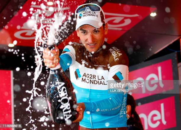 Team AG2R La Mondiale rider France's Nans Peters sprays champagne as he celebrates his victory during the podium ceremony after the stage seventeen...