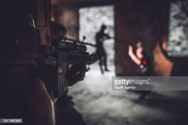 swat team aiming at gangster - terrorism stock pictures, royalty-free photos & images