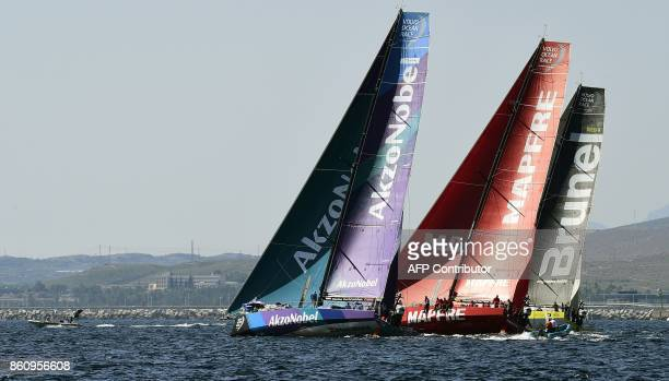 Team Akzonobel MAPFRE and Team Brunel sailboats sail on October 13 2017 off the coast of Alicante southeastern Spain during a training for the next...