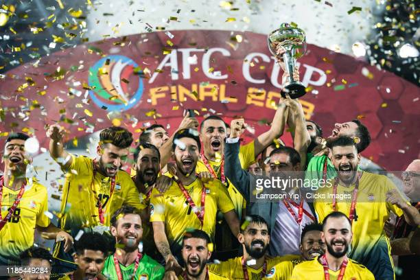 Team Al Ahed celebrating with the trophy during the award ceremony during the AFC Cup final between 4.25 SC and Al Ahed on November 04, 2019 in Kuala...
