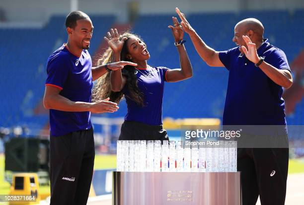 Team Americas representatives Christian Taylor and Caterine IbargŸen pose for a photo with Team Americas Ambassador Mike Powell prior to the IAAF...