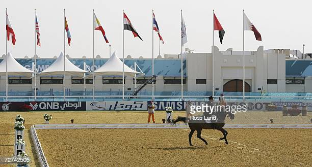 Team and individual dressage competitor Al Ejail Abdulla Ali Abdulla riding Quinten waves to the crowd as he leaves the Arena during competition at...