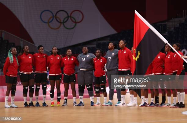 Team Angola are seen standing for their national anthem ahead of the Women's Preliminary Round Group A match between Montenegro and Angola on day two...