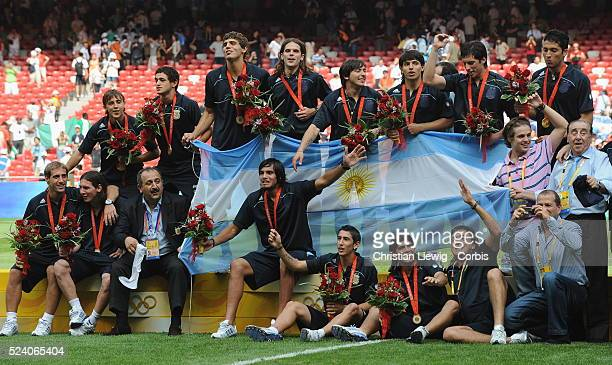 Team Argentina celebrating with their medals and flag after the men's gold match of football event between Nigeria and Argentina at Beijing 2008...