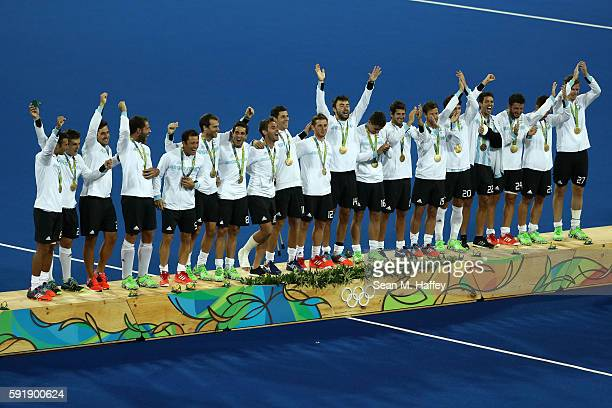 Team Argentina pose on the podium during the medal ceremony for the Men's Hockey Gold Medal match between Belgium and Argentina on Day 13 of the Rio...