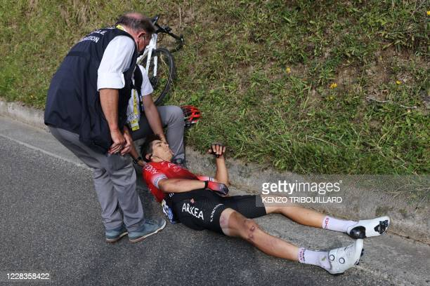 Team Arkea - Samsic rider Italy's Diego Rosa receives assistance after crashing during the 8th stage of the 107th edition of the Tour de France...