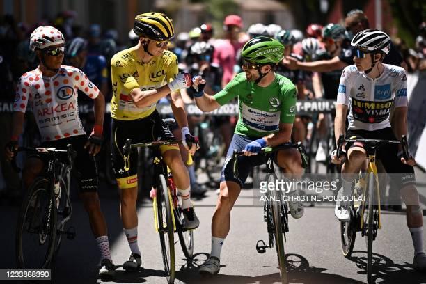 Team Arkea - Samsic's Nairo Quintana of Colombia wearing the best climber's polka dot jersey, Team UAE Emirates' Tadej Pogacar of Slovenia wearing...