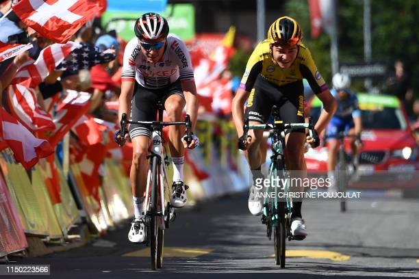 Team Arkea-Samsic rider France's Warren Barguil sprints with Team Jumbo-Vismarider US Sepp Kuss toward the finish line at the end of the eighth and...
