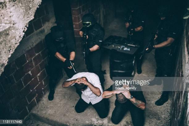 swat team arresting criminals - terrorism stock pictures, royalty-free photos & images