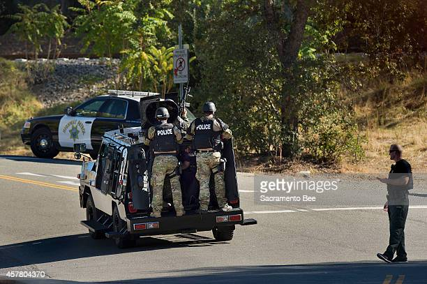 A SWAT team arrives to the area in Auburn Calif in response to an officerinvolved shooting on Friday Oct 24 2014 A suspect armed with a rifle left...