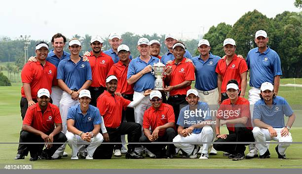 Team Asia and Team Europe celebrate together after the first EurAsia Cup finished in a tie They are pictured after the single matches on day three of...