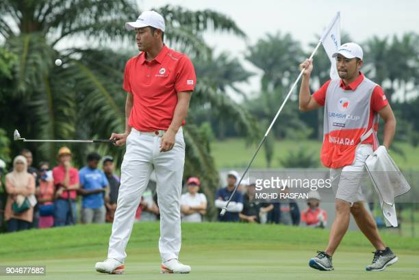 Team Asia's Hideto Tanihara of Japan reacts after missing a putt during the singles matches of the 2018 Eurasia Cup Golf tournament at the Glenmarie...