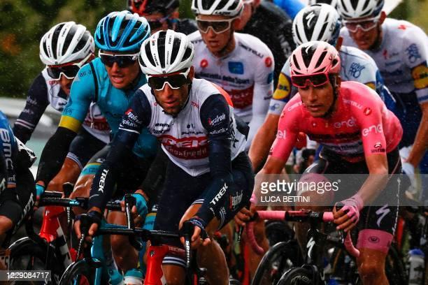 Team Astana Denmark's rider Jakob Fuglsang, Team Trek Italy's rider Vincenzo Nibali and Team Deceuninck Portugal's rider Joao Almeida, wearing the...