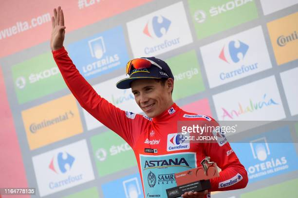 Team Astana rider Colombia's Miguel Angel Lopez celebrates wearing the leader´s red jersey on the podium of the seventh stage of the 2019 La Vuelta...