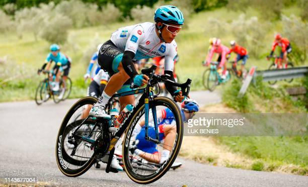 Team Astana rider Colombia's Miguel Angel Lopez Moreno White jersey of the leader of the young rider category ride with peloton during the stage four...