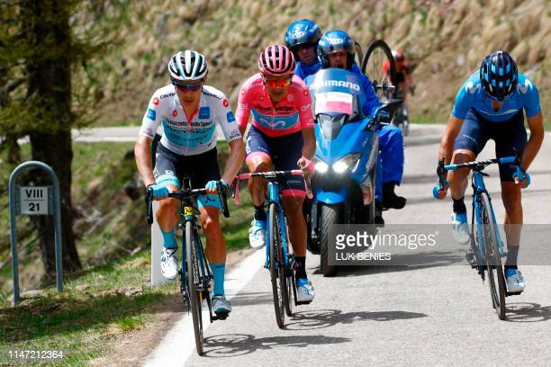 Team Astana rider Colombia's Miguel Angel Lopez Team Movistar rider Ecuador's Richard Carapaz wearing the overall leader's pink jersey and Team...