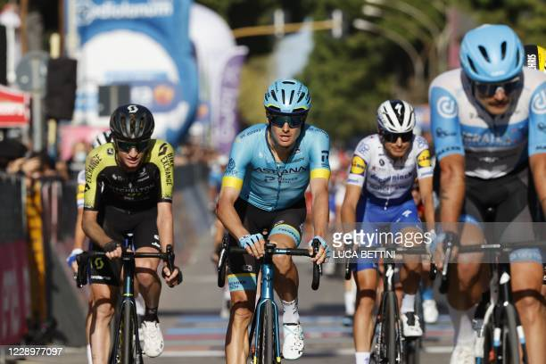 Team Astana rider Denmark's Jakob Diemer Fuglsang crosses the line in the seventh stage of the Giro d'Italia 2020 cycling race, a 143-kilometer route...