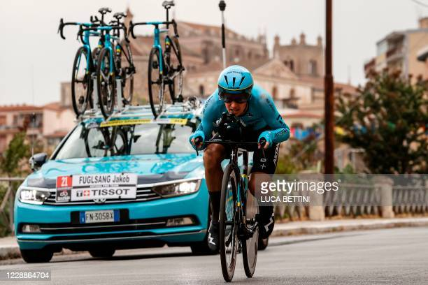 Team Astana rider Denmark's Jakob Diemer Fuglsang rides past the Santa Maria Nuova cathedral of Monreale during the first stage of the Giro d'Italia...