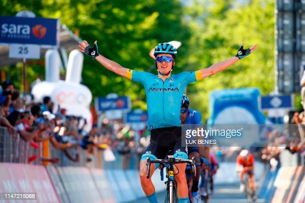 Team Astana rider Spain's Pello Bilbao celebrates as he crosses the finish line to win stage twenty of the 102nd Giro d'Italia Tour of Italy cycle...