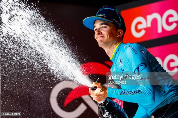 Team Astana rider Spain's Pello Bilbao celebrates on the podium with sparkling wine after winning stage seven of the 102nd Giro d'Italia Tour of...