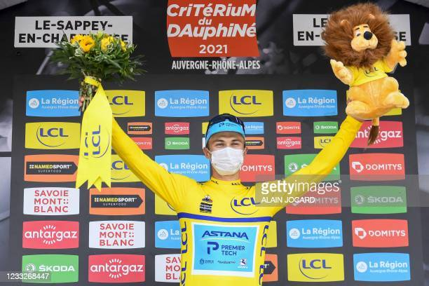 Team Astana's Alexey Lutsenko of Kazakhstan celebrates his overall leader's yellow jersey on the podium at the end of the the sixth stage of the 73rd...