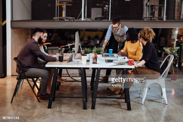 team at work. - design studio stock pictures, royalty-free photos & images