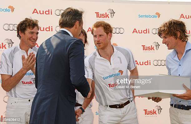 Team Audi Ultra members Luke Tomlinson Andre Konsbruck Director of Audi UK Mark Tomlinson Prince Harry and William MelvilleSmith attend day one of...
