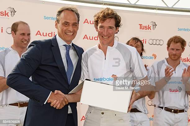 Team Audi Ultra members Prince William Duke of Cambridge Andre Konsbruck Director of Audi UK Luke Tomlinson Mark Tomlinson and Prince Harry attend...