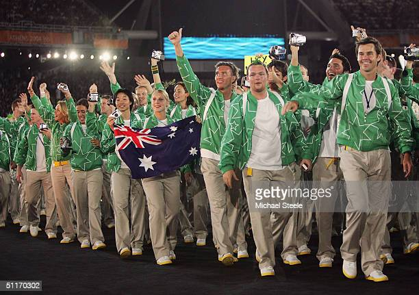 Team Australia acknowledges the crowd as they walk onto the field during the opening ceremony of the Athens 2004 Summer Olympic Games on August 13,...