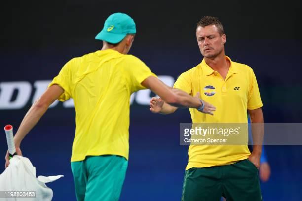 Team Australia captain Lleyton Hewitt celebrates with Alex de Minaur of Australia during his semifinal singles match against Rafael Nadal of Spain on...