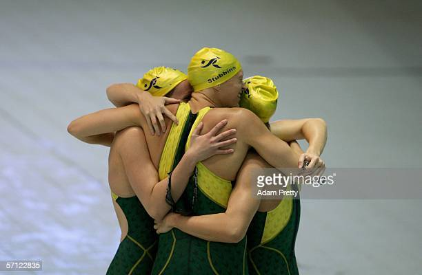 Team Australia celebrates after they won the final of the women's 4 x 200 metres freestyle relay at the Melbourne Sports Aquatic Centre during day...