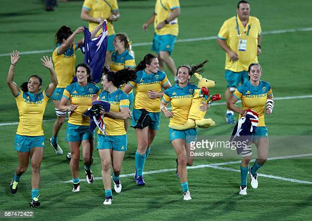 Team Australia celebrates winning the Gold medal after the Women's Gold Medal Rugby Sevens match between Australia and New Zealand on Day 3 of the...