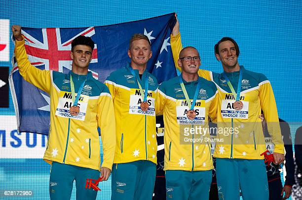 Team Australia celebrators with their bronze medals after the mens 4x100 Freestyle final on day one of the 13th FINA World Swimming Championships at...