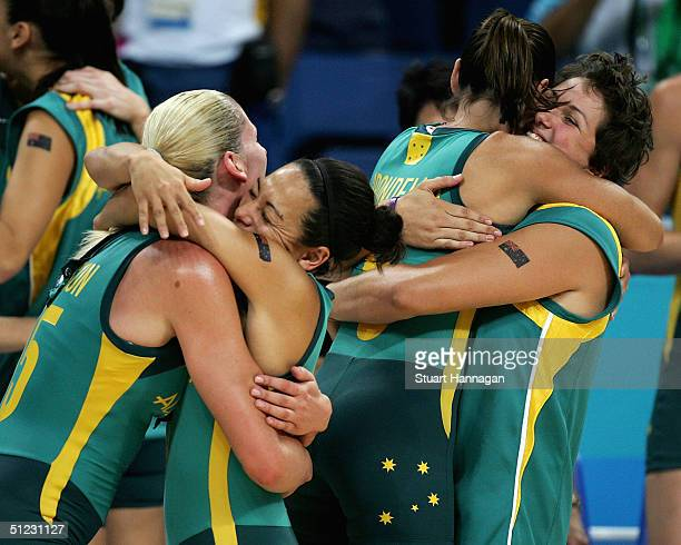 Team Australia including Lauren Jackson and Sandra Brondello console each other after a silver medal in the women's basketball gold medal match...