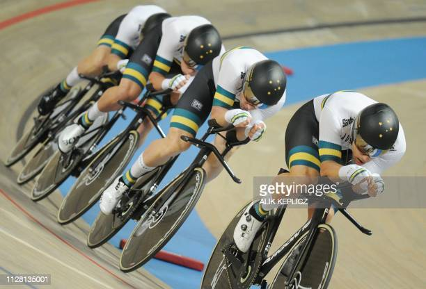Team Australia's cyclists Samuel Welsford Julius O'Brien Leight Howard and Alexander Porter compete in the Men's Team Pursuit Final race at the UCI...