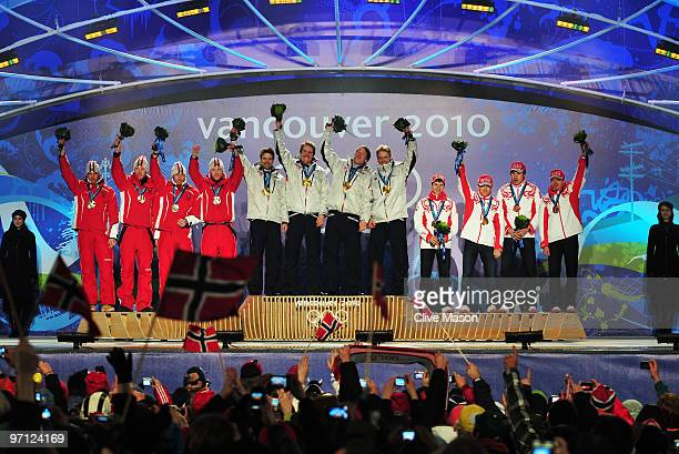 Team Austria celebrates winning the silver medal team Norway gold and team Russia bronze during the medal ceremony for the men�s 4 x 75 biathlon...