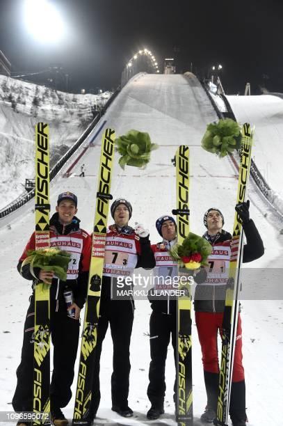 Team Austria of Gregor Schlierenzauer Michael Hayboeck Stefan Kraft and Philipp Aschenwald celebrate the victory in the ski jumping Team competition...