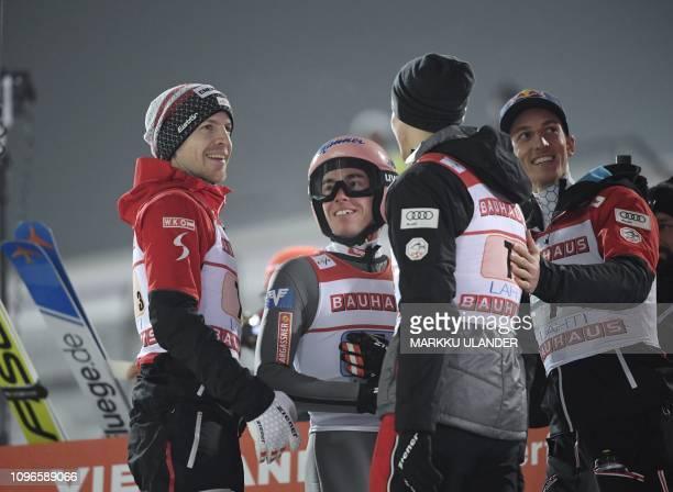 Team Austria of Michael Hayboeck last jumper Stefan Kraft Philipp Aschenwald and Gregor Schlierenzauer celebrate the victory in the ski jumping Team...