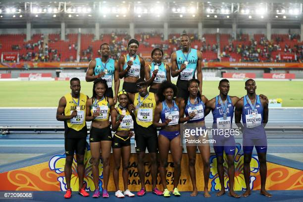 Team Bahamas first place team USA second place and team Jamaica third place celebrate after the Mixed 4x400 Metres Relay Final during the IAAF/BTC...