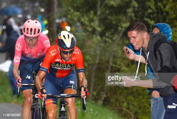 Team Bahrain rider Italy's Vincenzo Nibali climbs followed by Team Education First rider Great Britain's Hugh Carthy during the stage sixteen of the...