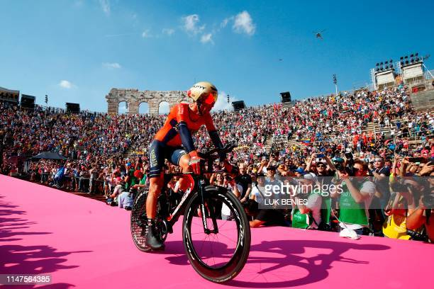 Team Bahrain rider Italy's Vincenzo Nibali enters the arena after competing in stage twentyone the final stage of the 102nd Giro d'Italia Tour of...