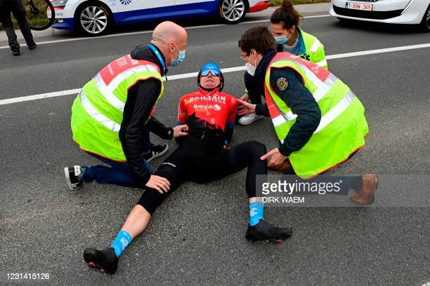 Team Bahrain Victorious Ukrainian rider Mark Padun is attended by medics after a fall during the World Tour 2021 Omloop Het Nieuwsblad one day...