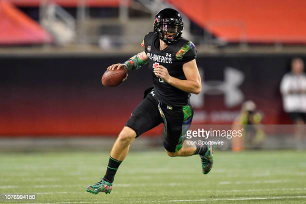 Team Ballaholics quarterback Bo Nix rolls right during the Under Armour AllAmerica Game between Team Flash and Team Ballaholics on January 03 at...