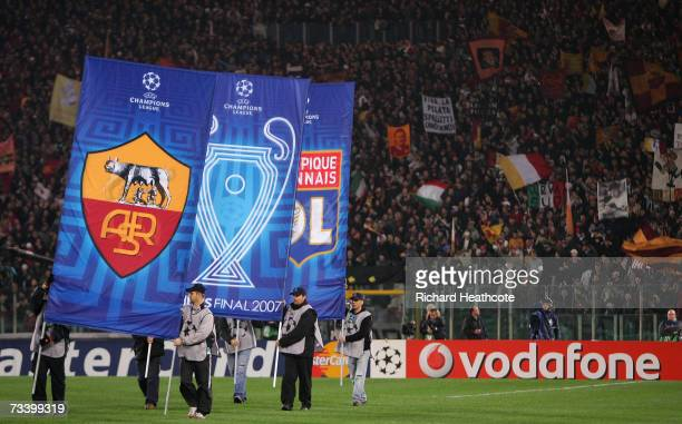 Team banners are brought into the ground before the start of the UEFA Champions League round of 16 first leg match between AS Roma and Olympique...