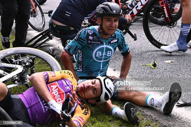 Team B&B KTM's Bryan Coquard of France and a Team Alpecin Fenix' rider lie on the ground after crashing during the 1st stage of the 108th edition of...