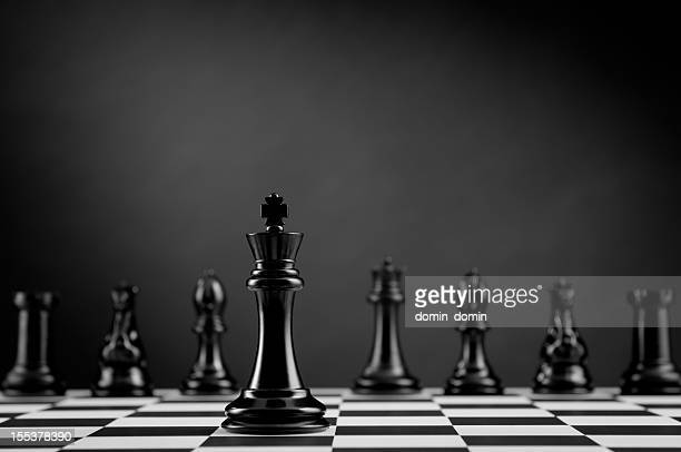 Team, Black Chess King on chess board, leader and competition