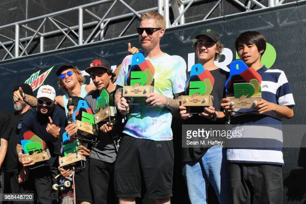 Team Blind TJ Rogers Micky Papa Bill Weiss Trey Wood and Yuto Horigome of Japan react after winning the Team Challenge at the 2018 Dew Tour on June...