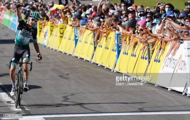 Team Bora rider Germany's Lennard Kamna celebrates as he crosses the finish line at the end of the fourth stage of the 72nd edition of the Criterium...